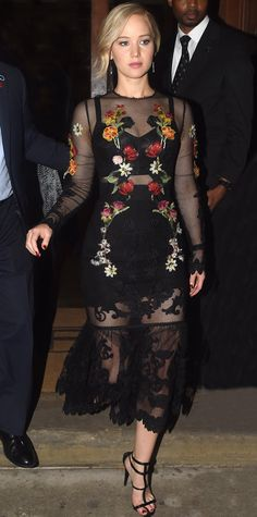 Look of the Day - Jennifer Lawrence - from InStyle.com Jennifer Lawrence celebrated The Hunger Games book launch in a racy sheer black floral-embroidered Dolce & Gabbana design, complete with black Giuseppe Zanotti strappy sandals.