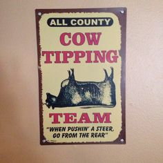 Cow Tipping Team: The Tipsy Cow Restaurant & Bar. Downtown Madison, Wisconsin.