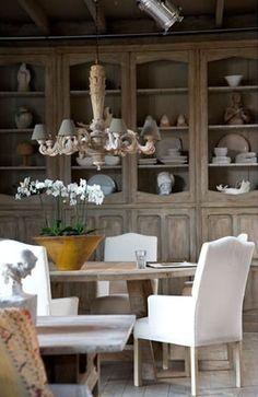 Fabulous dining area of a wonderful seaside Belgian loft- fabulous antique cabinet!