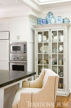 There's no need to hide your crockery away if it's displayed in a pretty French cabinet like this | Traditional Home