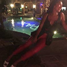 """Pin for Later: Go Inside One Fashion Insider's Coachella Diary  """"Could barely move in these vintage red leather pants but they were worth it!"""" Outfit details: Negative Underwear top and vintage leather pants"""