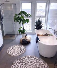 Open shower spaces, green plants, mandala rugs and candles all make this large b. - Open shower spaces, green plants, mandala rugs and candles all make this large bathroom a peaceful - Diy Bathroom Paint, Bathroom Spa, Modern Bathroom, Bathroom Plants, Family Bathroom, Bathroom Ideas, Remodel Bathroom, Bathroom Organization, Bathroom Candles