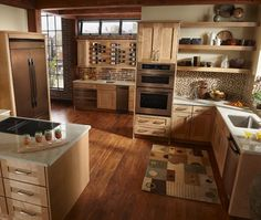 Oiled bronze is a warm alternative to stainless steel. Old-worldly warmth in a modern kitchen