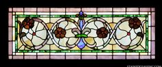 A filigree pattern with flowers and a fleur-de-lis is the design on this stained glass transom window. Description from stainedglassinc.com. I searched for this on bing.com/images