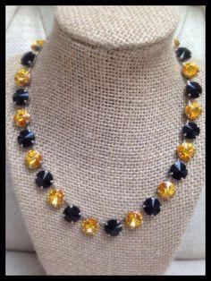 Black and gold large round Swarvoski crystal spirit necklace. Go team!