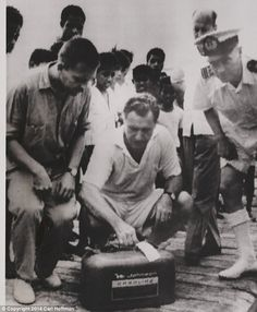 Nelson Rockefeller and Rene Wassing (left) examine the gasoline can that was picked up by the Dutch Navy. It may have been one the cans that Michael had attached to his belt when he swam to shore