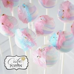 Cotton candy cake pops...pastel swirl vanilla cake pops decorated with real cotton candy and edible gold flake
