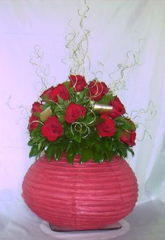 Chinese lantern flowers! Ever thought to use a lantern for a vase? I know someone who has and made it look awesome! ©Naples Flowers