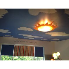 Add these clouds on the ceiling (think the rainbow idea or even the Narnia idea or an animal/nature) and you have a total package.