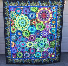 Hello and welcome. Here is my second entry in the Blogger's Quilt Festival. It's my la passacaglia quilt, which is in the hand quilted category.  This beautiful pattern was designed by Willyne Hammer