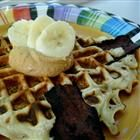 Banana Waffles Recipe -- I just made these and they are wonderful.  Instead of adding bananas to the batter right when putting it on the iron, I mashed up two over-ripe bananas right to the mixing batter.  Perfect!