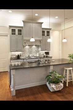 Hoping our kitchen turns out like this. love the beadboard around the island.