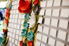 We're seeing paper flowers pop up more and more as decorative elements.
