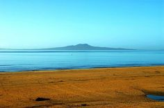 View of Rangitoto Island volcano from Browns Bay Beach. Auckland is built on volcanoes. Auckland New Zealand, Kiwiana, Volcanoes, Home And Away, Places Ive Been, Destinations, Wanderlust, Island, Sunset