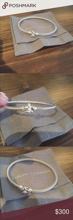 David Yurman Fleur-de-lis 3mm Bracelet Authentic David Yurman 3mm cable bracelet accented with diamonds and the fleur-de-lis at the clasp (including pouch) David Yurman Jewelry Bracelets