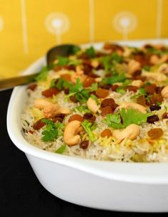 Fluffy fragrant rice, richly spiced vegetables, and a scattering of raisins, cashews, and herbs make up this colorful and warming biryani