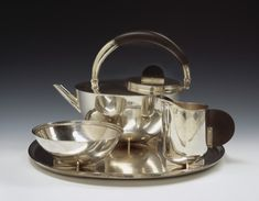 Marianne Brandt, Tea Service: Tea Infuser (Pot), Creamer, Sugar Bowl, and Tray, 1924 (design, manufactured between 1924 and 1929), hammered sterling silver and ebony. Smart Museum of Art, University of Chicago, Anonymous Gift in memory of Liesl Landau, 20