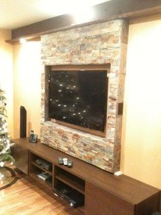 TV wall mount and entertainment center.  Would look nice in family room