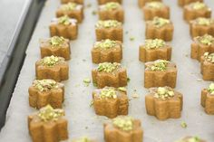 Persian Chickpea Cookies with Pistachio (Nan-e Nokhodchi) is a crumbly, melt-in-your-mouth cookie, made with the fragrant flavours of rose water, cardamom and pistachio.   aheadofthyme.com
