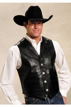 For authentic, classic, western apparel at an affordable price, Roper is the brand to trust. This classic western style mens leather vest features a notched collar and front and back yokes. This high quality outerwear item is both durable and stylish. Cowboy Outfits, Western Outfits, Western Dresses, Western Vest, Western Style, Revival Clothing, Groom Wear, Leather Vest, Mens Fashion