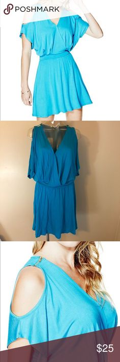 "G by Guess Edlyn Cosmos Dress Beautiful dress G by Guess 95%Rayon 5% Spandex. Machine wash  Measures laying flat  Shoulder to shoulder 14""  Waist 14.5""  Length 37""   * Care label cut by half and original tags has been removed this to prevent store returns. G by Guess Dresses Midi"
