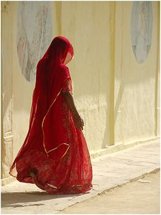 woman in red, jaisalmer by nevil zaveri (Click on photo to visit photostream in Flickr)