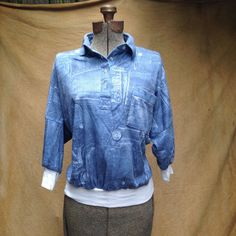 """1980s Jean Print Shirt Batwing Slouchy Women's Small. Whoa Nelly! This is a fun top. I'd say, roller skating or hanging out at the mall are what you do in this shirt. Oh, and pop that collar!  Details Size: S Shoulders: 21"""" Chest: 44"""" Sleeve: 9"""" Waist: 28"""" Length: 23""""  Brand: Jinny Jin, Made in USA Color: Blue, White"""