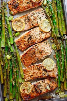 Lemon, garlic and parsley are infused in this salmon while it bakes in your oven in only 10 minutes. All on One Pan Lemon Garlic Baked Salmon + Asparagus is the best and easiest way to get salmon on your dinner table! Potato And Asparagus Recipe, Baked Salmon And Asparagus, Roasted Salmon, Potato Recipes, Fish Recipes, Seafood Recipes, Low Carb Recipes, Cooking Recipes, Healthy Recipes