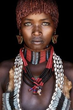 smooth black skin in traditional african adornment