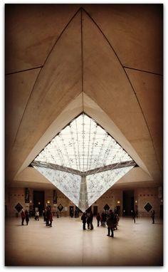 Inside 'La Pyramide du Louvres,' Paris, France.