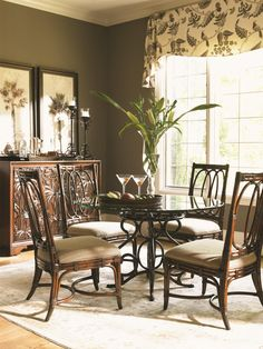 A fancifully scrolled metal base energizes the look of your dining set, bringing class and luxury island style to every meal
