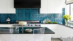 Bored with your pure white kitchen? Try adding a dose of light — or bright — color to liven up your