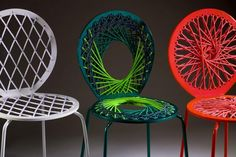 """parabolic """"string"""" chairs"""