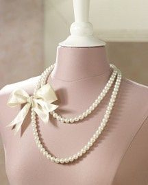 Simple and classic...do it yourself by tying a ribbon onto your favorite pearls or pin on your favorite broach for a whole new look!