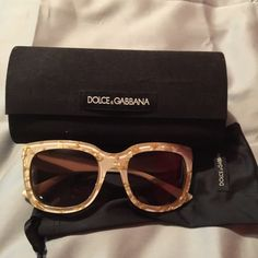 Dolce & Gabbana sunglasses Beautiful cream colored Dolce & Gabbana sunglasses with gold chips inside throughout. Original case and cloth. Excellent condition. No trades. Dolce & Gabbana Accessories Sunglasses