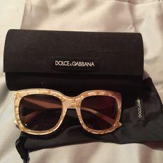 Dolce & Gabbana sunglasses Beautiful cream colored Dolce & Gabbana sunglasses with gold chips inside throughout. Original case and cloth. Excellent condition. No trades. Dolce & Gabbana Accessories Sunglasses