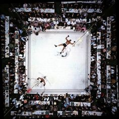 Aerial view of Muhammad Ali standing victorious after a third round knockout of Cleveland Williams their 1966 during fight at The Astrodome. (Neil Leifer/SI) SI VAULT: Ali in charge, scores easy victory over Williams GALLERY: A Tribute to Muhammad Ali Mohamed Ali, Houston Tx, Boxe Fitness, Neil Leifer, Sting Like A Bee, Float Like A Butterfly, Landscape Photography, Rare Photos, Mixed Martial Arts