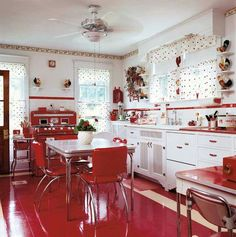 Love this red 1950's style kitchen! Make me want to tie on an apron and start cooking!