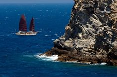 """Traditional wooden hip """"Athena"""" sailing past the lighthouse of Northern Paros !"""