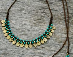 sale, tribal necklace, boho necklace, ethnic necklace, turquiose necklace, collar,gold, turquoise and red, ethnic jewelry, goddess necklace    I like to call this design Maharni because it echoes to me the ancient feeling of a hindu princess in her court.  This necklace is tribal and Lusciously feminine, with a majestic allure, adding a boho touch to any look.  I weave it from the highest quality Italian waxed cord ( which does not tear or fray), with solid brass beads, and Howlite Turquoise…