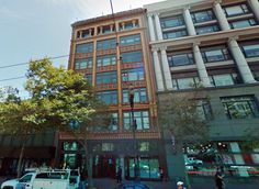 973 Market, a seven-story loft structure from 1908. It stands out not for any structural gyrations — no tilting prows or zippered silhouettes here — but for the intricate and freshly cleaned tile work that covers the facade, a cloak of ornamentation at once flamboyant and prim. Photo: Google Maps