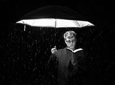 He put the flash inside his umbrella  on this dark rainy night.  I want to try this, that is if it ever rains again this desert of mine!    Light Reading by Pichead, via Flickr