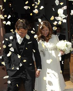The Confetti  Though tennis balls would have been apropos, flower petals made for a much prettier shot at Roger Federer's wedding!