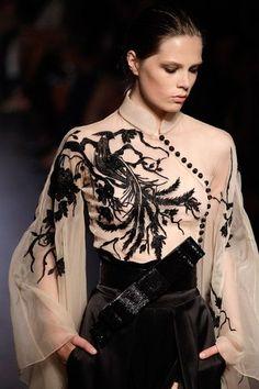 Kimono like sleeves, Phoenix detail, Mandarin collar, bow sash, Cheong Sam side button detail. Amazing Oriental collaborative design style.