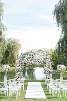 This outdoor wedding is oh-so picturesque. | Photography: Carly Mills Photography | WedLuxe Magazine #luxurywedding #torontowedding #eventdecor #floraldesign #floralcanopy #outdoorwedding
