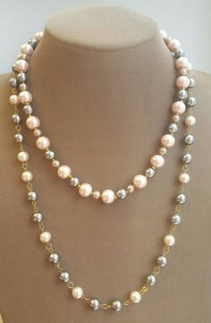 Check out this item in my Etsy shop https://www.etsy.com/ca/listing/487714124/two-strand-pink-and-grey-pearl-necklace