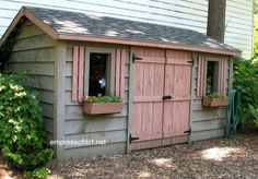 Gray shed with light pink drim, barn-style doors, and window boxes | Gallery of best garden sheds