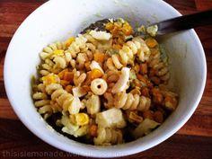 Warm pasta salad with fusilli bucati, corn, egg and avocado