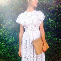 East Hampton: Mia wears Hydra Broidery Dress, Leather Beach Clutch in Tan.