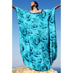 Stunning silk Kaftan rose buds. French Kiss Turquoise. ❤ liked on Polyvore featuring tops, rosette top, silk caftan, blue top, blue kaftan and silk kaftan